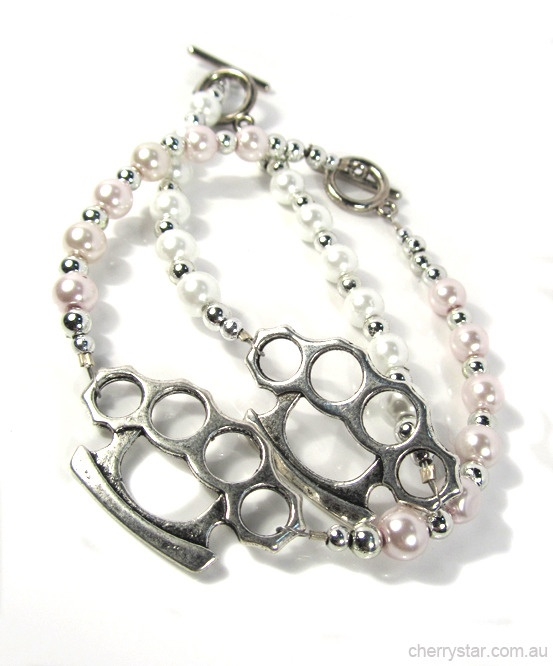 Introducing the Bruiser Bracelet...  Available with white or soft pink glass pearls.  Antiqued silver finish knuckle duster.  Delicate with a tough edge, the Bruiser isnt just a pretty face!  Pair up with the Bruiser Necklace.  Hand made by Cherry Star.