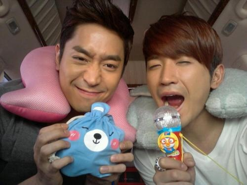 Lee Min Woo - with leader Eric :). They were filming a kids special episode where they got to play with and take care of a bunch of the cutest kids of Korea (3 Moon brothers in present, hooray!!!). What a cuteness-overloaded show! :)