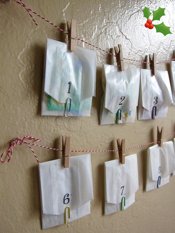 Advent Calendar - see a theme yet?  My daughter might like this...I'd put red glitter on the clothes pins and maybe the #'s.