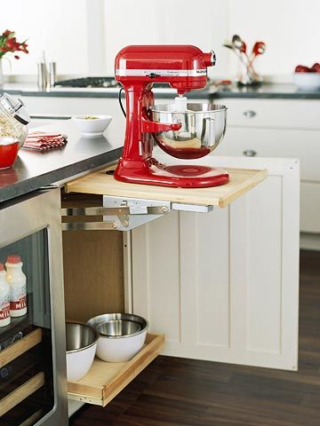 Mixer storage shelf that lifts up so you can use it without taking up counter space :)