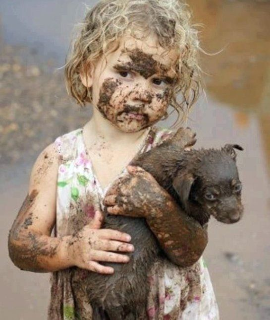 Shower Time? No harm in a little mud when you have a cute puppy to cuddle!