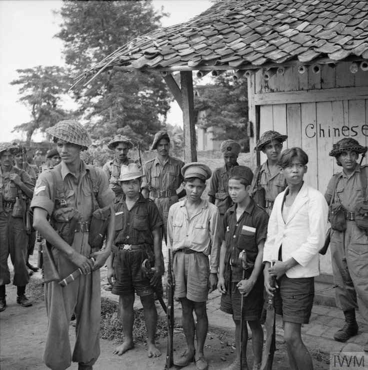 Indian troops with four armed Indonesians captured at Bekassi before the village was burnt as a reprisal for the murder of five members of the Royal Air Force and twenty Maharatta riflemen whose Dakota transport aircraft crash landed near the village.