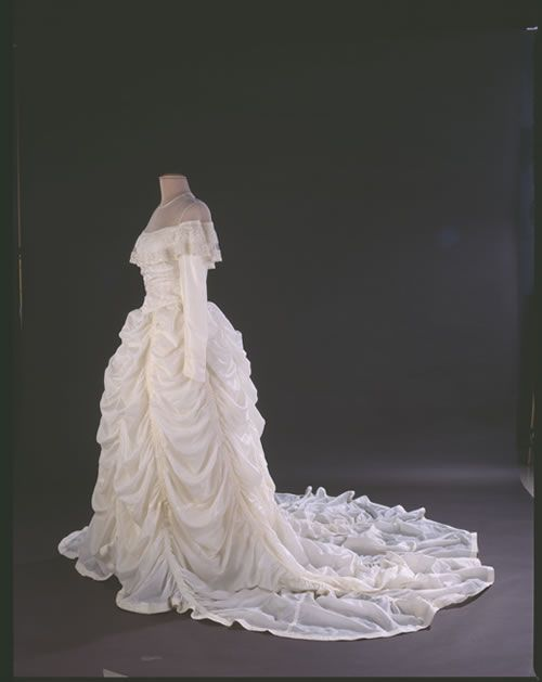 This wedding dress was made from a nylon parachute that saved Maj. Claude Hensinger during World War II.  In August 1944, Hensinger, a B-29 pilot, and his crew were returning from a bombing raid over Yowata, Japan, when their engine caught fire. The crew was forced to bail out. Suffering from only minor injuries, Hensinger used the parachute as a pillow and blanket as he waited to be rescued. He kept the parachute that had saved his life. He later proposed to his girlfriend Ruth in 1947.