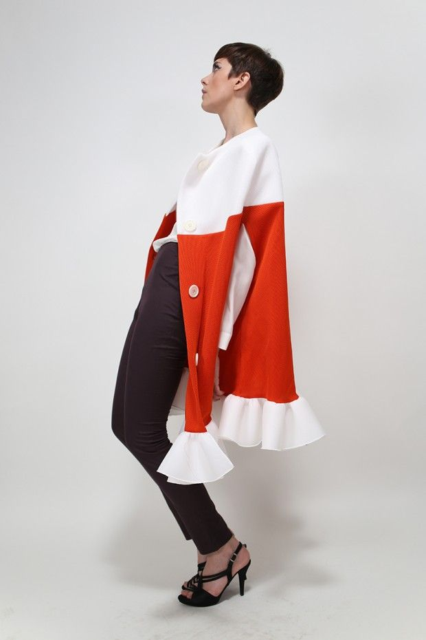 Techno-couture manteau from (n-1) couture's Indian Summer 2013 collection. Bold, graphic and sharp.  Autumn 2014 will be all about capes so what better way than to enjoy autumn than with (n-1) couture's Indian Summer ruffled manteau?