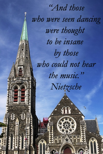 """""""And those who were seen dancing were thought to be insane by those who could not hear the music.""""  -- Nietzsche --  Photograph of Christchurch Cathedral, New Zealand, taken by Dr. Joseph T. McGinn  --  Enjoy reflective quotes at http://www.examiner.com/article/travel-a-road-of-literate-quotes-about-the-journey"""