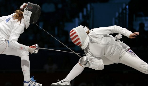 Courtney Hurley of the U.S. (R) competes against Russia's Anna Sivkova.  Amazing stance!