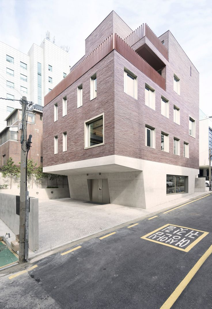 Top Heavy Office And Apartment Block Features Brick Top And Concrete Base.  Brick ArchitectureResidential ...