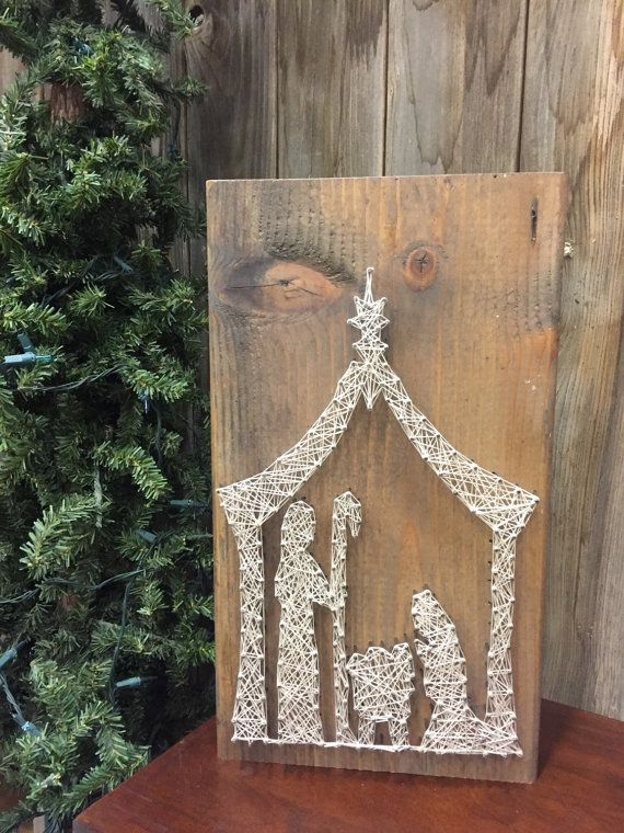 Nail string art on reclaimed wood. Basic nativity scene. (Knots in wood vary but I try to keep them hidden.)
