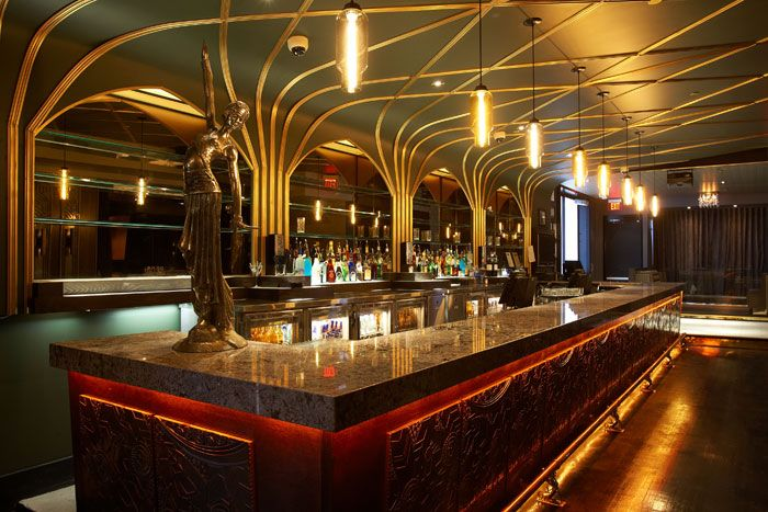 Art Deco! A white diamond granite counter tops the main bar, which is fronted with intricate metal panels and has griffin details...