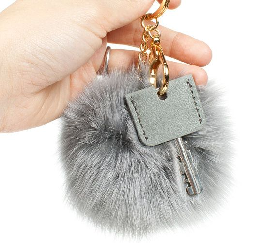 Fur pom pom Key chain with Leather Key cover Make your keys look cute with pompom key ring with leather key cover! :) Also, you can use it
