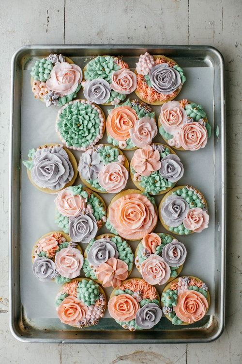 Learn how to pipe beautiful buttercream flowers on cookies! - from mynameisyeh.com