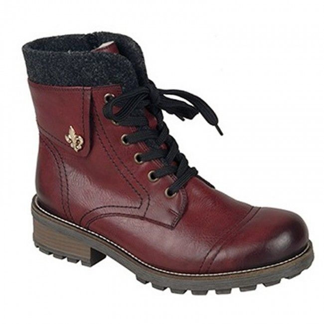 Women's ankle boots in bordeaux color. Zipper on the side for the best apply, non-slip rubber outsole and natural fur inside. In large sizes by Rieker.
