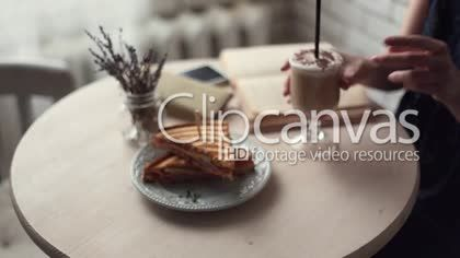 Woman reading book and drinking coffee at small cafe HD Stock Footage Clip. Close-up. 2016-02-02, RUSSIAN FEDERATION.