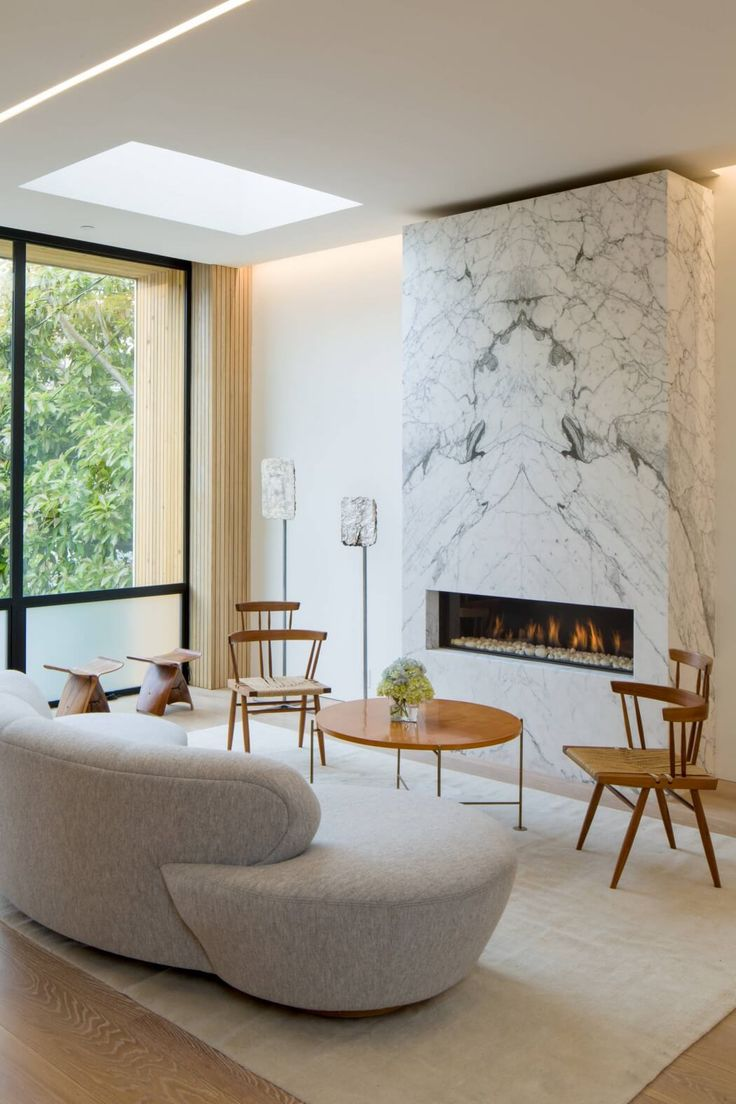 Cow Hollow Residence by Larson Shores Architects - Love the book-matched stone on the fireplace