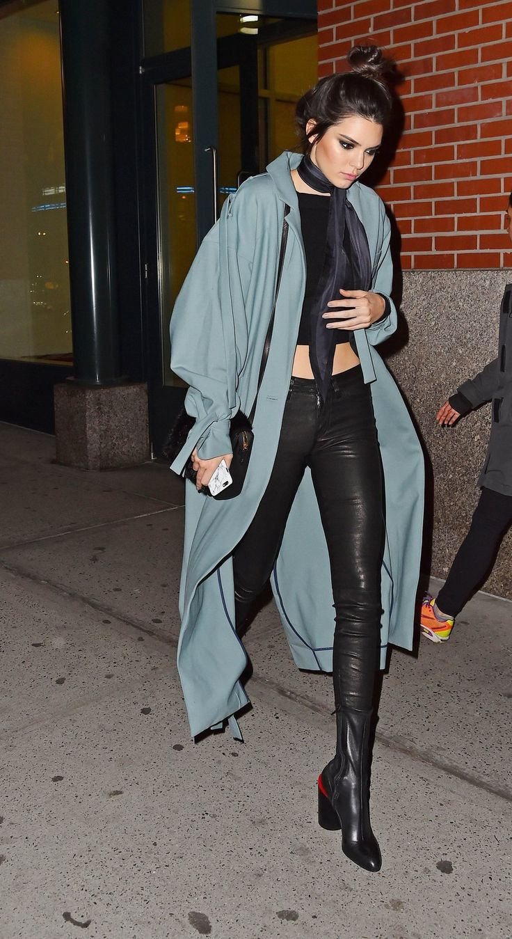Kendall Jenner -- A blue duster coat softens an all black look and looks super chic paired with a skinny scarf.