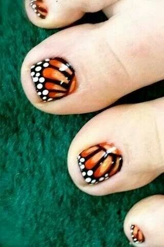 Butterfly toesies. I LOVE the ombre oranges used underneath the Butterfly design. But again, I only like the designs to be on the Big Toe. that's just my opinion