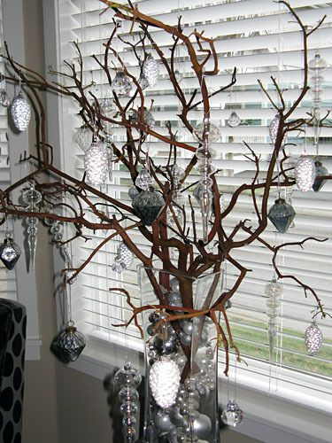 The Christmas branch decorated with ornaments...add some lights and snowflake decorations