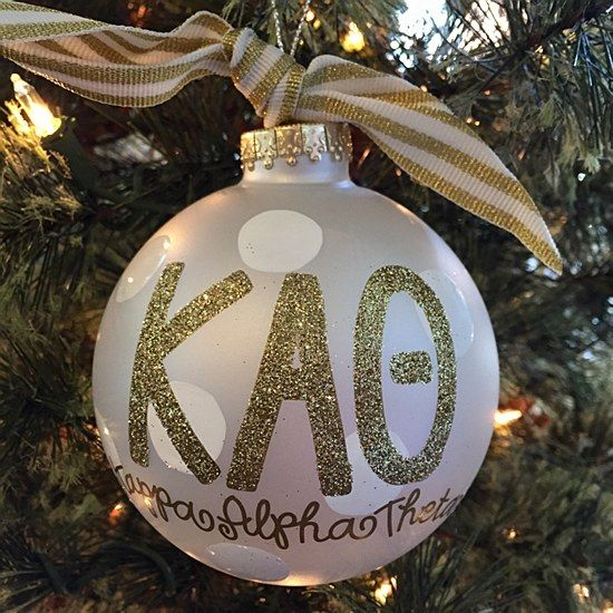 Kappa Alpha Theta - Glitter Gold Ornament: The Kappa Alpha Theta Gold Glitter Ornament is a must-have for any stylish sorority woman. With its classic white stripe ribbon and sparkly gold greek lettering, this ornament is the perfect holiday gift.  Comes packaged in a coordinating gift box for perfect present presentation.