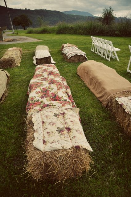 instead of everyone having to be in chairs, i love the hay bales with maybe indian print blankets or blankets like this.  they can be used around the firepit later...