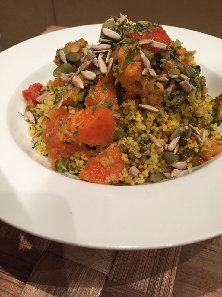 """• spiced cous cous with added chili powder, parsley flakes and turmeric and hemp seeds • topped with """"mushy veggies"""" (sweet potato, carrot, zucchini, broccoli) (from big batch made and frozen) • topped with seeds and more parsley flakes Can add any other meat protein if you wish smile emoticon"""