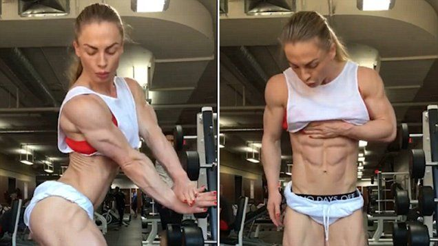 The woman poses for the camera as she flexes her ripped physique in the gym.