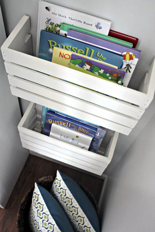 We love organization that doubles as display. Cut wooden crates in half and attach to the wall to display children's books (and keep them off the floor!)