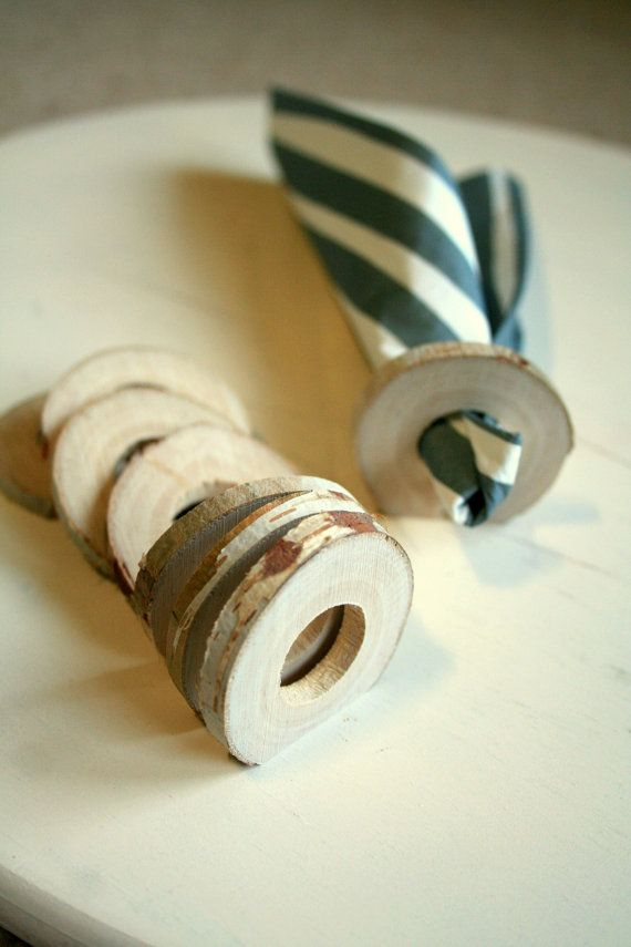 Beautiful napkin rings set in simple wooden