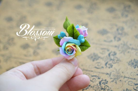 Hairpin with pastel roses. Made of polymer clay FIMO Cold porcelain leaves Metal base 3cm Turquoise heart beads Attached with epoxy…