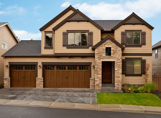 exterior color scheme from bm rich brown trim color accentuates the stone entryway