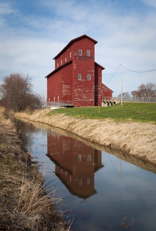 The M.J. Hogan Grain Elevator is the earliest remaining grain elevator built along the Illinois & Michigan Canal. The elevator, constructed in 1861-1862 by John Armour, allowed local farmers to ship their grain in bulk to Chicago markets via the canal, as opposed to transporting each load by horse and wagon.