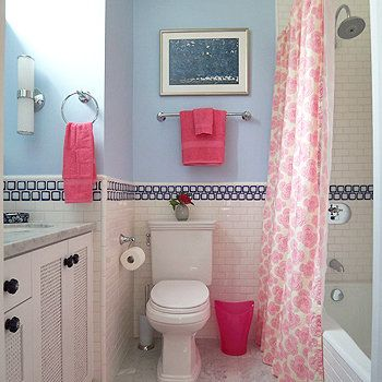 Design inspiration from across the globe! This Mediterranean-style girls bathroom, in a pink and blue color palette, is refreshing and elegant. The lotus flower shower curtain looks sophisticated against the blue walls and simple tile, while bright pink towels tie the room together perfectly. This is a bathroom that mom and daughter will both love! Source: Lotus Bleu