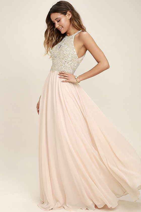 Make a stunning debut in the Principessa Blush Beaded Maxi Dress! A halter neckline (with clasp closures) tops a dazzling beaded bodice, with sequins and rhinestones, padded cups, and sultry front and back cutouts. Lightweight Georgette flows from a fitted waist into a full maxi skirt. Hidden back zipper/clasp.
