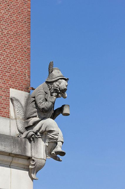 """Anheuser-Busch's Anthropomorphic Grotesque, """"Renard the Fox"""" enjoying a chicken leg and mug of beer decorates one of the Anheuser-Busch buildings in St. Louis, Missouri. Photo credit: Huzzah on flickr   ..rh"""