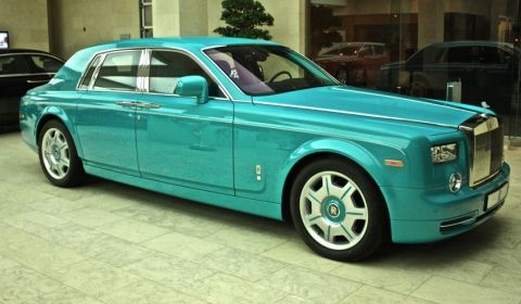 Turquoise rolls-royce phantom in Doha, Qatar made for the Al-Thani family who are obsessed with Turquoise vehicles