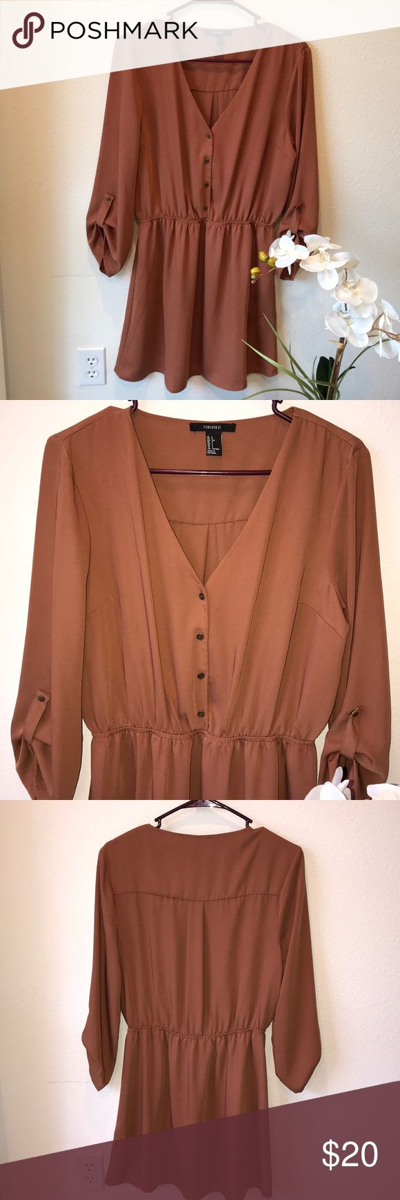 """Gorgeous brown dress EUC, size Large. Wear now as a Tunic with leggings and boots, wear later with sandals. Gorgeous dark camel brown color. 3/4 sleeves. Bust 21"""", waist 13"""" (flat)/ 19 1/2"""" (full stretch), length from waist 17."""" I ❤️offers! Stock pic shows similar fit. Forever 21 Dresses Mini"""