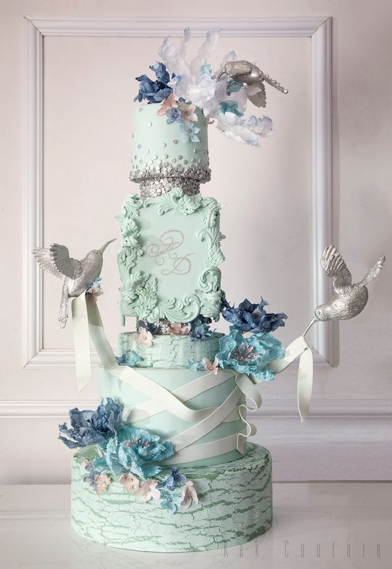 Gorgeously unique pale green wedding cake topped with blue flowers; Featured Cake: Kek Couture