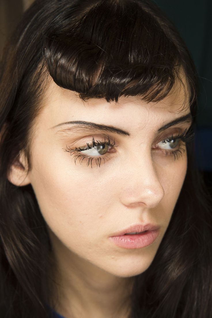 Lucia Pieroni created the doll-like look at Rochas, which comprised spidery long lashes and brows drawn on slightly above models' natural brows, each as one definitive line.