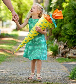 Back-To-School Tote: In Germany, it's a tradition to give children a schultute, a giant paper cone filled with treats and supplies, to celebrate their first day of school. @FamilyFun magazine
