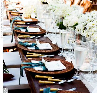 I love the #copper chargers with #teal ribbons surrounding the menus.