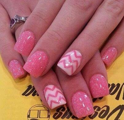 Pink sparkly nails with one nail white with pink Chevron style stripes