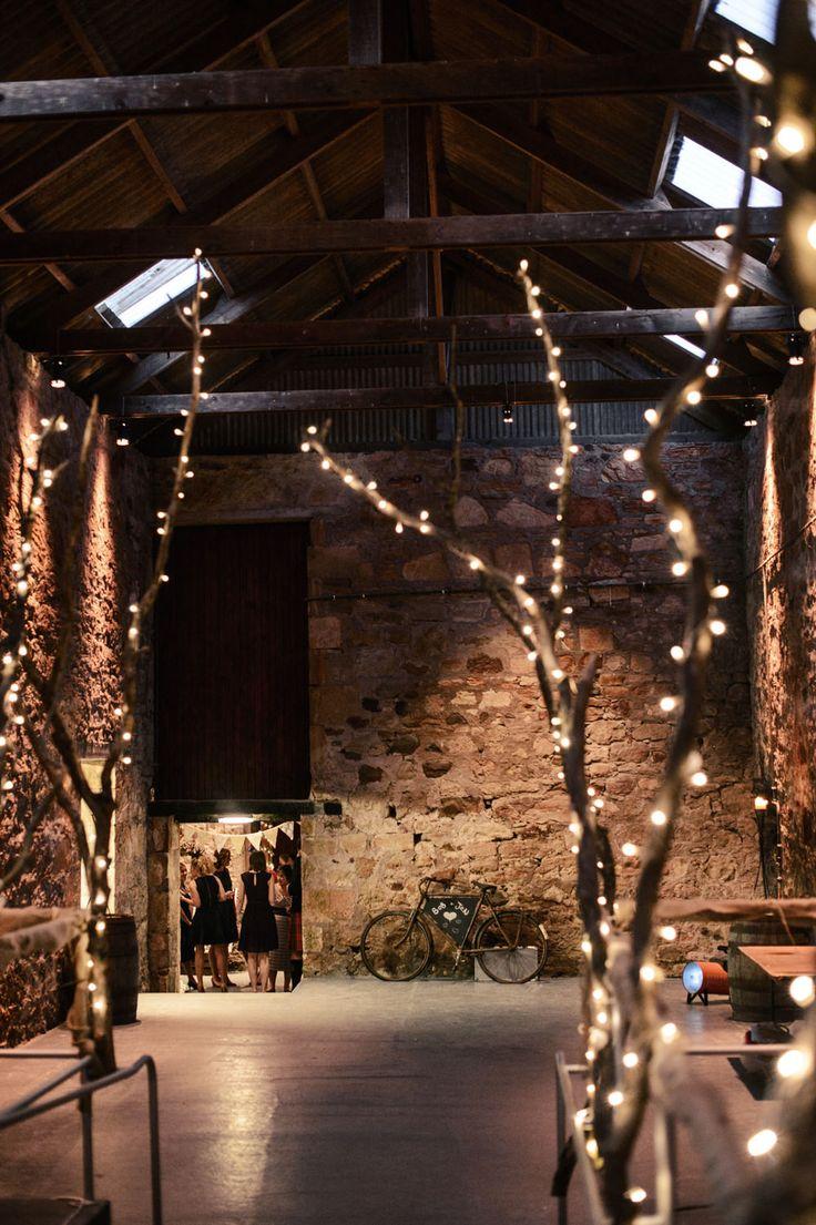Twinkling Twig Decor in the Kinkell Byre Barn  | Scottish Wedding | Autumn Wedding | Rustic Wedding | Barn Wedding | Grey & Yellow Colour Scheme | Image by Crofts & Kowalczyk Photography | http://www.rockmywedding.co.uk/jen-bob/