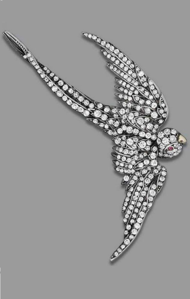 Formerly the property of Baroness Margaret Thatcher - A LATE VICTORIAN DIAMOND BROOCH, CIRCA 1880. Modelled as a swallow, set throughout with old circular-cut diamonds, a ruby to the eye, with additional haircomb fitting, 7.3 cm., mounted in silver and gold. #Victorian #antique #brooch