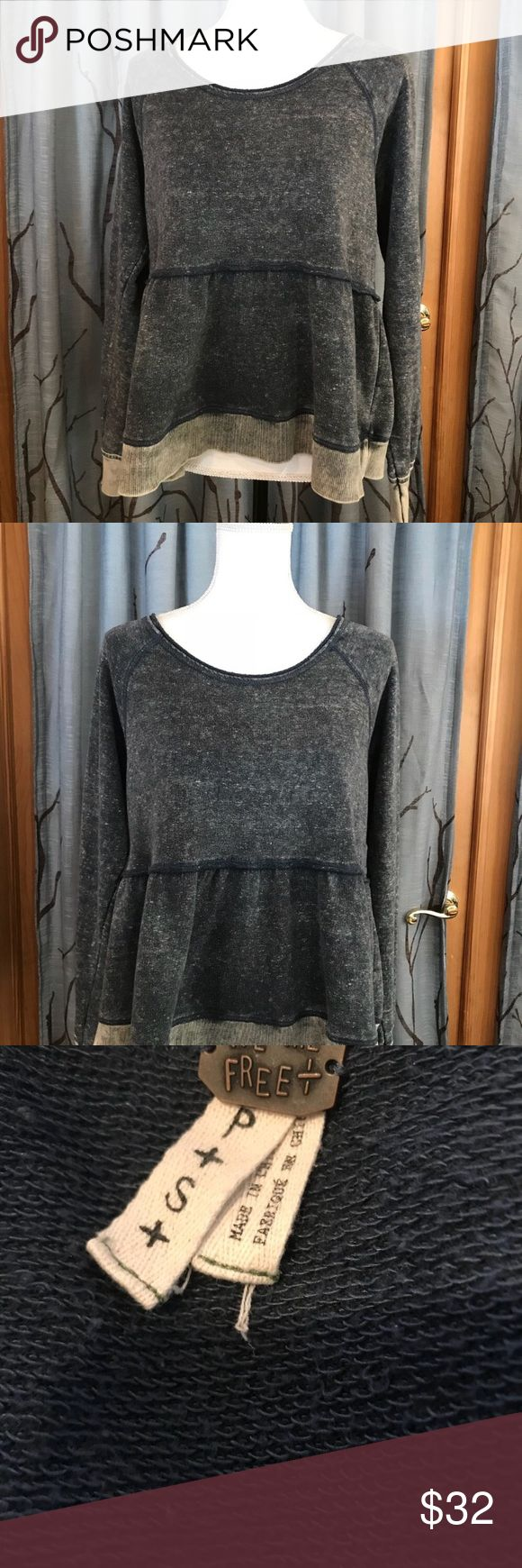 We the Free Free People size small baby doll top. We the Free Free People size small top. Baby doll fit with long sleeves. Soft sweatshirt type material in a marled blue with heather gray cuffs and hem for contrast Free People Tops
