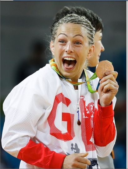 Britain's Sally Conway celebrates with her bronze medal during the medal ceremony for the womens's 70-kg judo competition, Aug. 10, 2016.