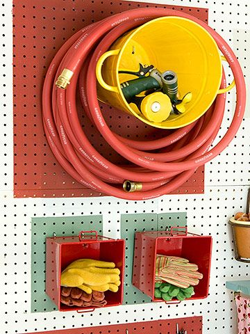 Attach metal buckets sideways to a garage wall for added storage. More DIY storage: http://www.bhg.com/decorating/do-it-yourself/accents/diy-storage-for-every-room/?socsrc=bhgpin091512wallbucketstorage=4