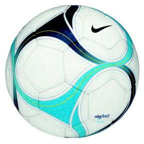 Nike white soccer ball with blue accents. Dad, the former captain of a hometown soccer team.