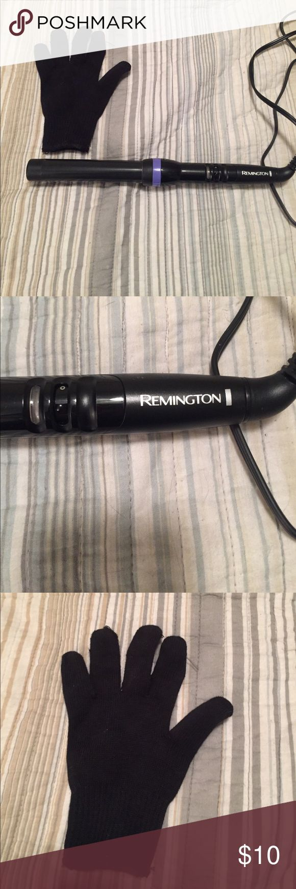 Remington curling wand This is a fairly new Remington curling wand without the clip that a normal curling iron has. It comes with a heat protective glove since it has no clip. I used this maybe 2 or 3 times, and just couldn't get the hang of how to use it. It works just fine, just not my thing. remington Accessories Hair Accessories
