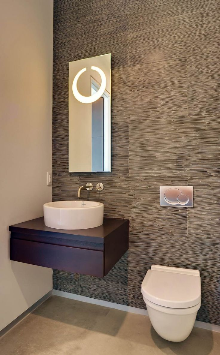 Modern Small Powder Room Design Featuring Cool Grey Wood Grain Tiles Wall Accent And Small Dark