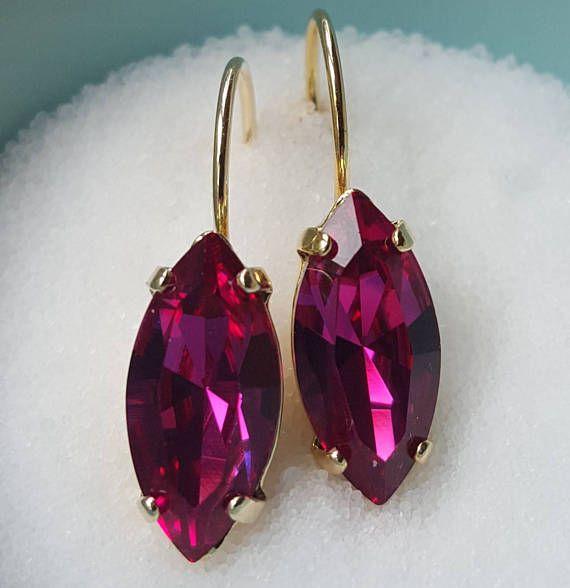 Check out this item in my Etsy shop https://www.etsy.com/ca/listing/535047409/navette-fuchia-swarovski-crystal-gold