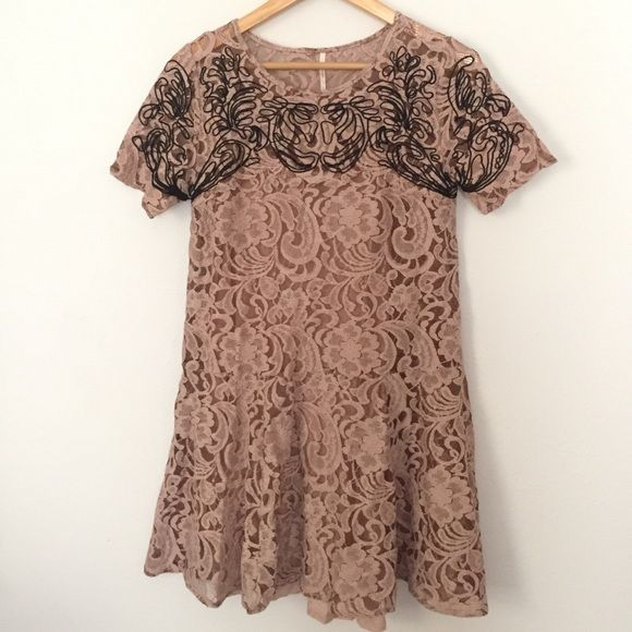 Free people lace dress Adorable tan lace dress with black detailing. Great condition! Built in slip. Final price unless bundled. No trades, please! Free People Dresses